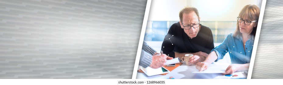 Business people working together in office, overlaid with network, light effect. panoramic banner