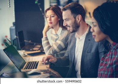 Business people working together in office.