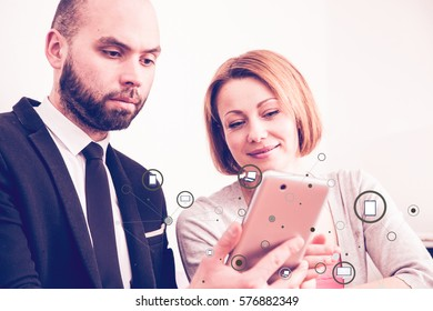 Business people working together on a tablet, drawn  communicating connection with various devices.