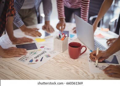 Business people working together on creative office desk