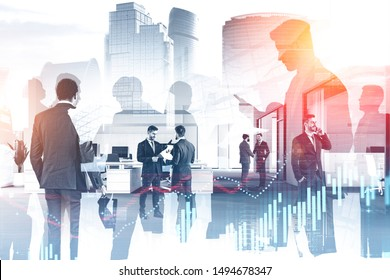 Business people working together in stylish office with double exposure of cityscape and graphs. Concept of trading and stock market. Toned image