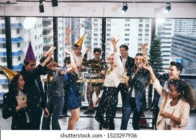 Business peple celebrate to success project on chrismas and new year at office with a glass of champagne