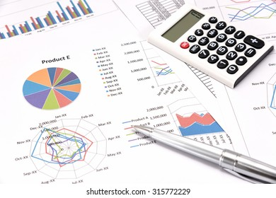 Business performance analysis. Business Graphs with calculator, pen.