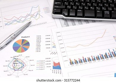 Business performance analysis. Business Graphs with Keyboard, pen.