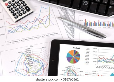Business performance analysis. Business Graphs with tablet, pen.