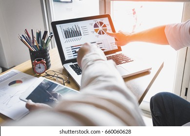 Business person analyzing financial statistics displayed on the laptop screen