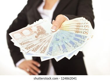 Business person in black suit paying in Euros as a bribe