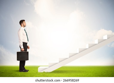 Business person climbing up on white staircase in nature background concept