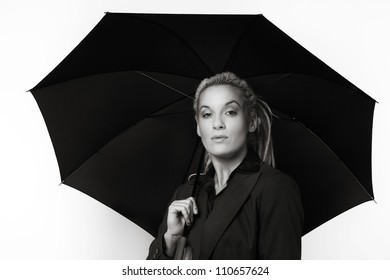 Business person with dreadlocks hair holding and under a open up umbrella