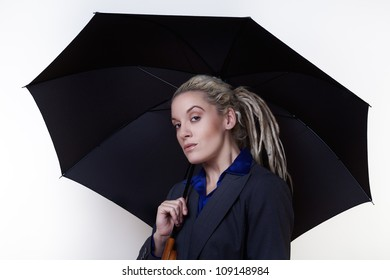 Business person with dreadlocks hair standing on white background holding note book and pen