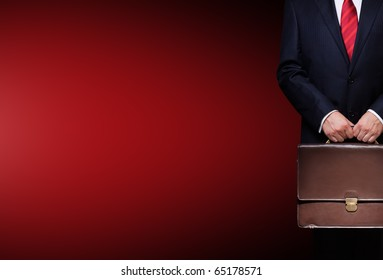 business person holding a briefcase