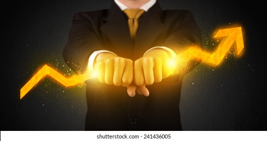 Business person holding a hot glowing upright arrow concept on background