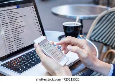 Business person reading emails on smartphone and laptop computer screen online, communication and marketing concept