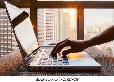 Business person using laptop computer