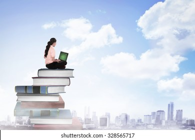 Business person working with laptop on  the top of books. Career and education concept