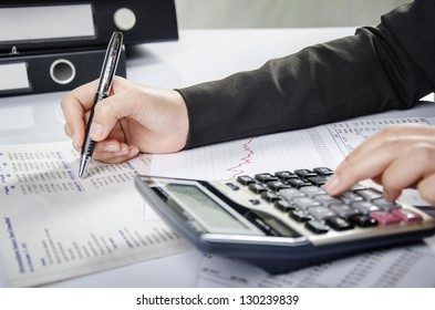 Business person working on financial report