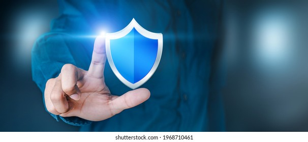 Business personnel touch the shield icon to safeguard data or networks, and virus security is ensured. Insurance and data protection Information security against viruses, business security principles - Shutterstock ID 1968710461