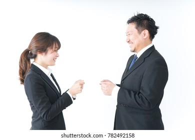 Business persons exchanging  business cards