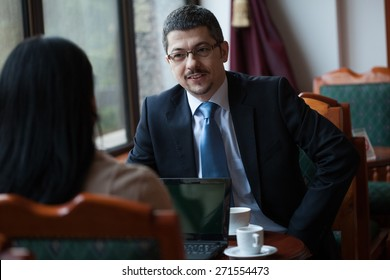 Business persons in meeting
