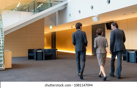 Business persons walking in the hall. Global business concept.