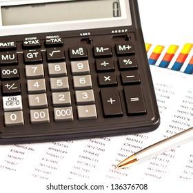 Business picture: calculator, financial graphs, pen
