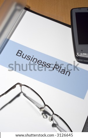 business plan binder on desk lit stock photo edit now 3126645