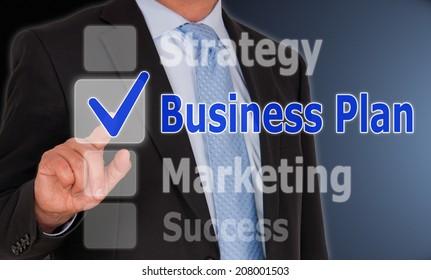 Business Plan - Businessman touching Button or Touchscreen