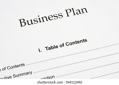 Business plan document and pen, close-up