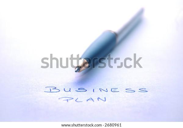 BUSINESS PLAN text below fountain pen - office work