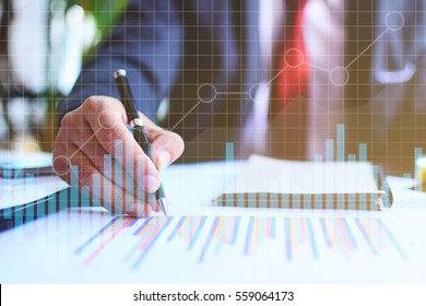 Business planning. Marketing strategy brainstorming. Paperwork and digital in open space. Statistic graph overlay, icon innovation interface