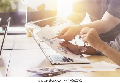 Business plan,Team work concept,team meeting,Business people using laptop at office,  Trainee crew working with new startup project laptop.Project managers Analyze plans.selective focus,vintage color