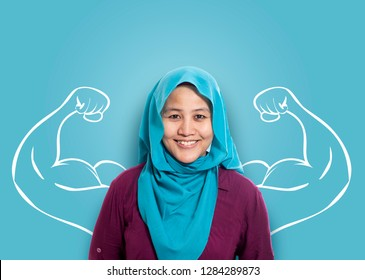 Business power concept. Young Asian muslim businesswoman smiling with strong powerful arms drawn behind. Inner power authority