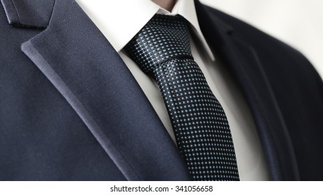 Business Power, Detail closeup - jacket men's, shirt with a blue tie