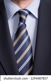 Business Power, detail of a man jacket with a blue tie