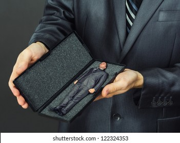 Business present - small businessman in box
