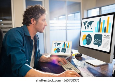 Business presentation of charts and map against businessman working on computer Businessman working on computer in office
