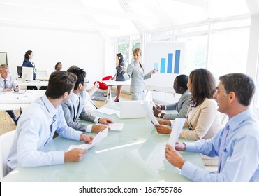 Business Presentation of a Corporate Woman to her Colleagues