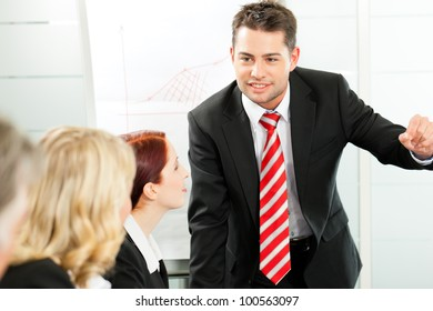 Business - presentation within a team, a colleague is explaining the strategy