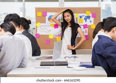 Business problem concept - Irritated asian businesswoman at business meeting and Spiritless employee bored with work meeting presentation ignores manager boss. selective focus