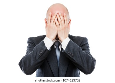 Business problems and failure at work concept - unhappy crying tired or stressed businessman in depression hand hiding face white isolated