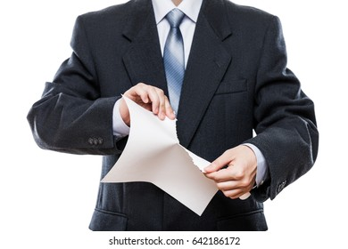 Business problems and failure at work concept - angry businessman in black suit hand tearing paper document white isolated