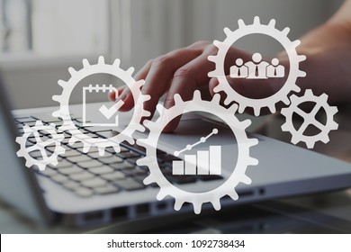 Business process and ERP concept. Icons of gears, cogwheels and charts with businessman working on computer on background.