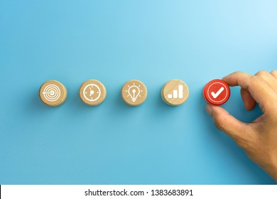 Business process management, Businessman plan a project with wooden cubes with icon business strategy on blue background. copy space