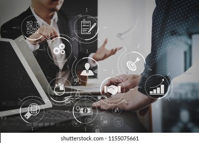 Business process management with workflow automation diagram and gears in virtual flowchart.co working team meeting concept,businessman using smart phone and digital tablet and laptop computer.