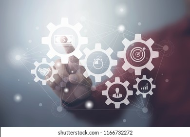 Business process management and workflow automation diagram with gears and icons with connection line network in background. Manager touching interface