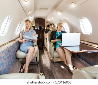 Business professional traveling in corporate jet