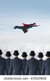 business progress concept superhero businessman flying past static competition