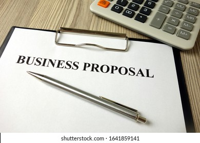 Business proposal document with pen and calculator, financial concept