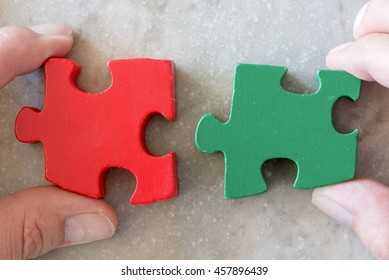 Business puzzle strategy. Two jigsaw pieces as metaphor for strong partnership, teamwork and success.