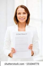 business and real estate concept - businesswoman holding contract